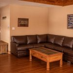 Creekside-Chalets-ColumbiaThreeBedroom_leather-couch-min